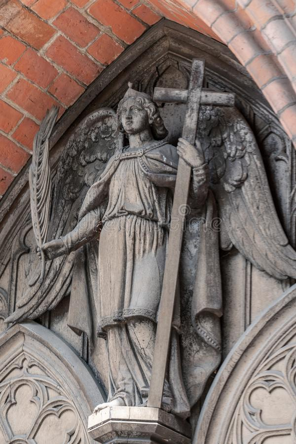 Φωτογραφία λεπτομέρειας ενός αγγέλου στον κακό καθεδρικό ναό Doberan στοκ φωτογραφία