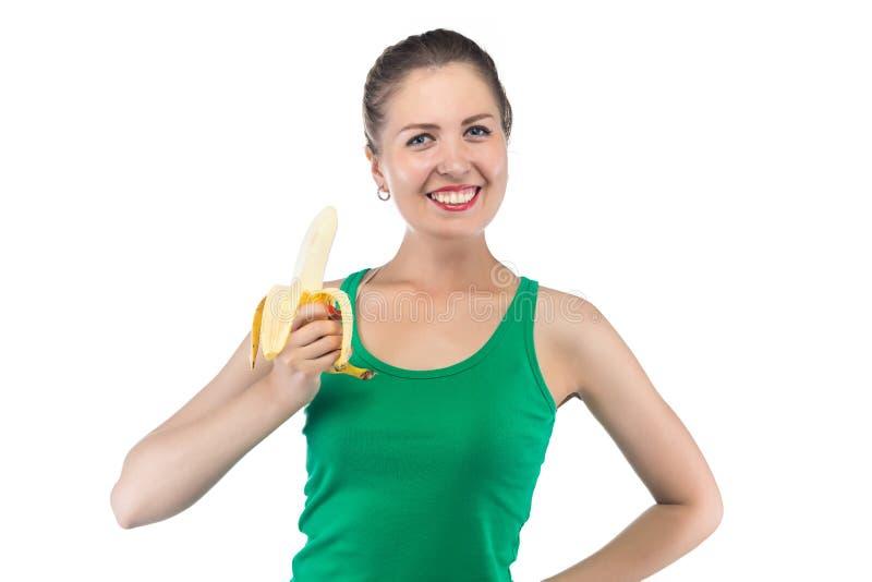 Φωτογραφία της ευτυχούς χαμογελώντας γυναίκας με την μπανάνα στοκ εικόνα