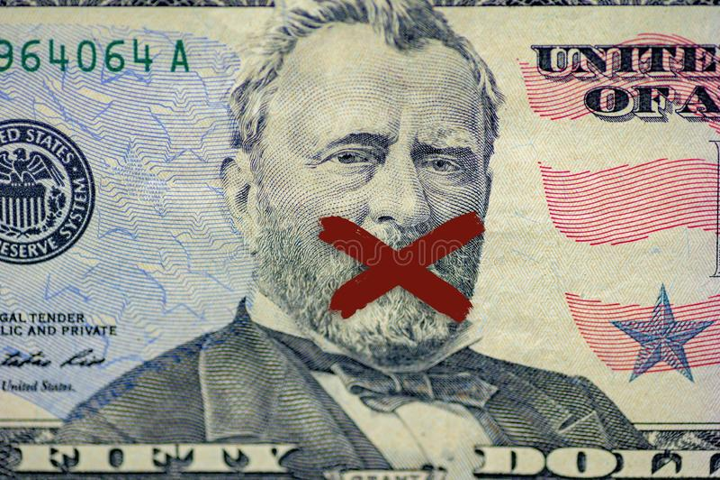 Φωτογραφία των Οδυσσέων πρόσωπο με επιχορήγηση στο χαρτονόμισμα με ένα χ ζωγραφισμένο στο στόμα του στοκ φωτογραφία με δικαίωμα ελεύθερης χρήσης