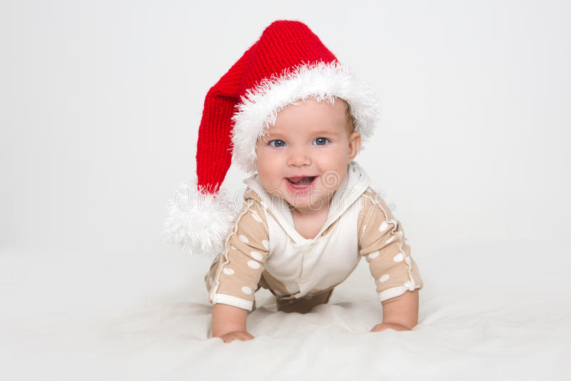 Φωτογραφίες του νέου μωρού σε ένα καπέλο Άγιου Βασίλη στοκ φωτογραφίες