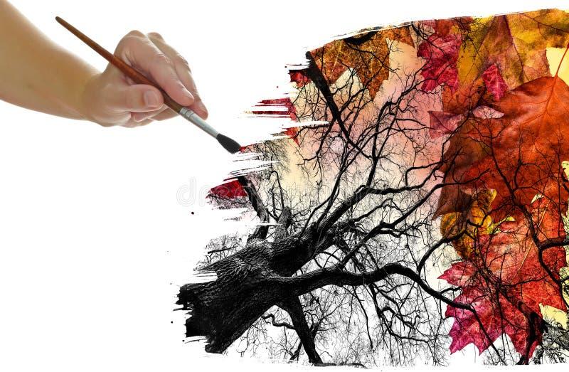 Φύλλωμα φθινοπώρου ζωγραφικής χεριών στοκ εικόνα