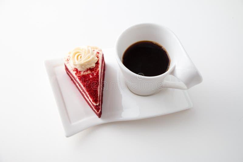 Φλιτζάνι του καφέ με το εύγευστο κόκκινο κέικ βελούδου στοκ φωτογραφίες