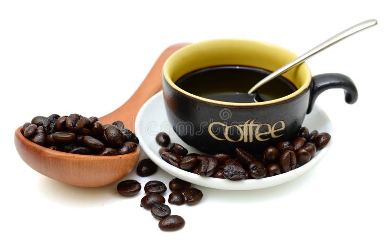 Φλυτζάνι και φασόλια καφέ στοκ εικόνες