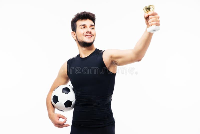 Φλυτζάνι νικητών εκμετάλλευσης ποδοσφαιριστών στοκ φωτογραφία με δικαίωμα ελεύθερης χρήσης