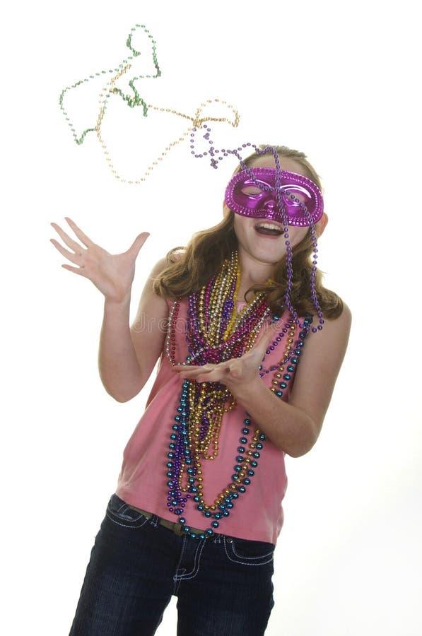 Download χάντρες που πιάνουν το Mardi Gras κοριτσιών Στοκ Εικόνες - εικόνα από κορίτσι, childhood: 22790460