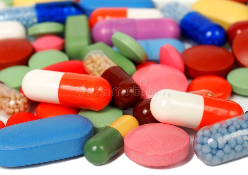 Χάπια και κάψες στοκ εικόνα