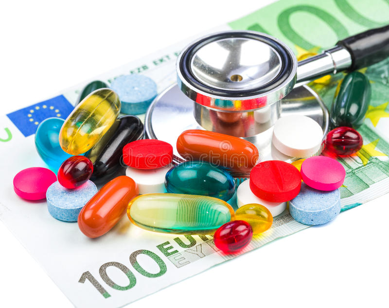 Χάπια και χρήματα στοκ εικόνες με δικαίωμα ελεύθερης χρήσης