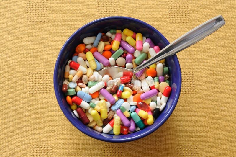 χάπια κύπελλων στοκ εικόνα