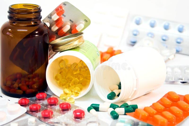 χάπια μπουκαλιών που ανατ στοκ εικόνες