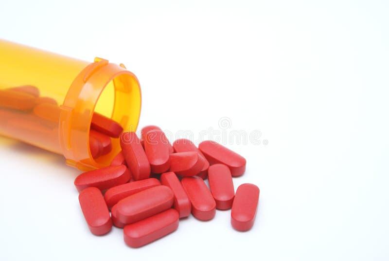 χάπια που ανατρέπονται στοκ φωτογραφία