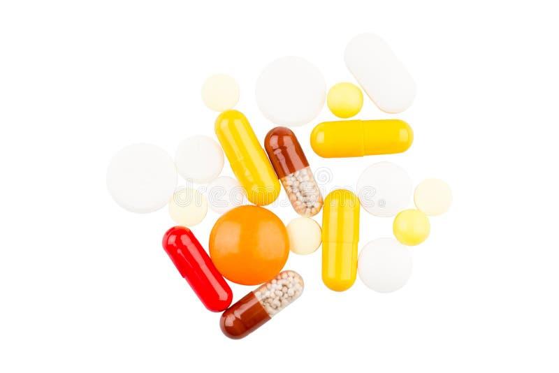 Χάπια στην άσπρη ανασκόπηση στοκ φωτογραφία με δικαίωμα ελεύθερης χρήσης