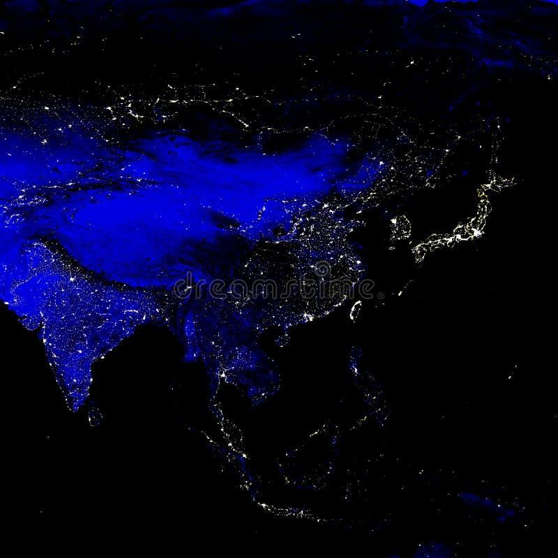 Χάρτης ηλεκτρικών φω'των ηπείρων της Ασίας τη νύχτα Ηλεκτρικός φωτισμός των πόλεων τη νύχτα απεικόνιση αποθεμάτων