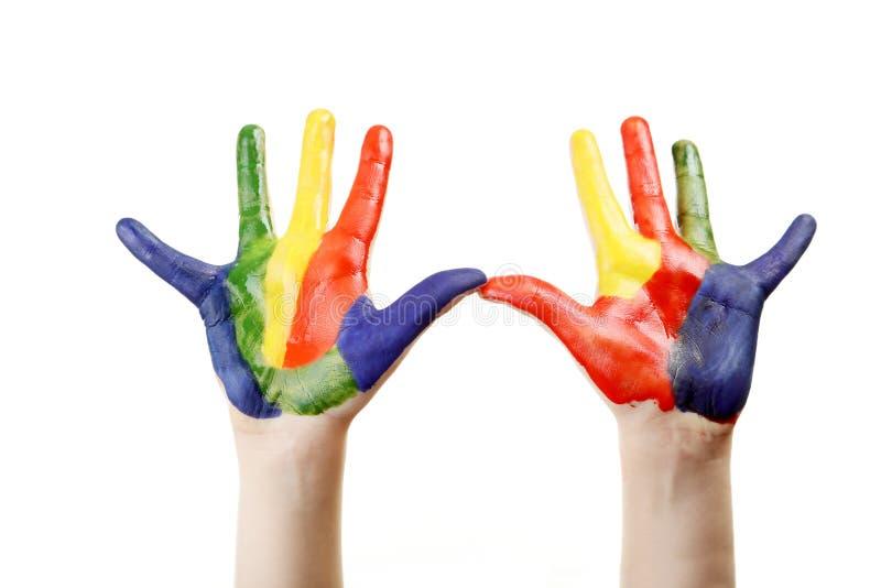 Χέρια αγοριών που χρωματίζονται στοκ φωτογραφίες