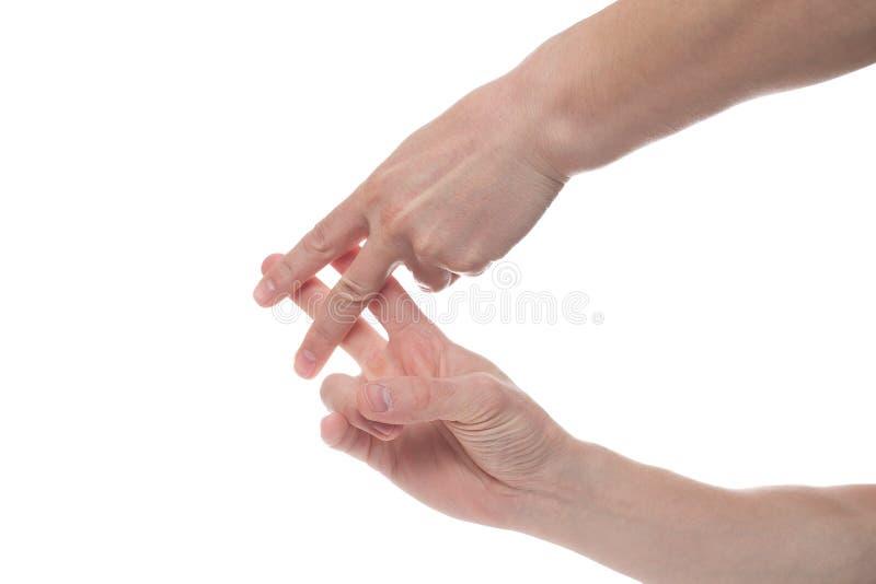 Χέρια ατόμων που παρουσιάζουν πλέγμα με τα δάχτυλά του που απομονώνεται στο άσπρο υπόβαθρο στοκ φωτογραφία