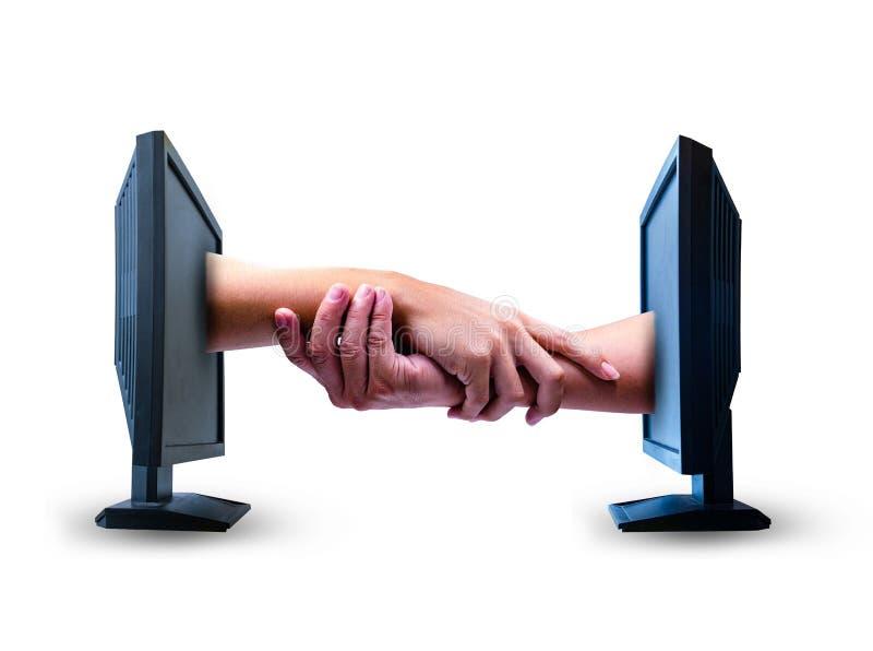 Χέρια επιχειρησιακών κουνημάτων από δύο οθόνες υπολογιστή στο άσπρο υπόβαθρο στοκ φωτογραφία με δικαίωμα ελεύθερης χρήσης