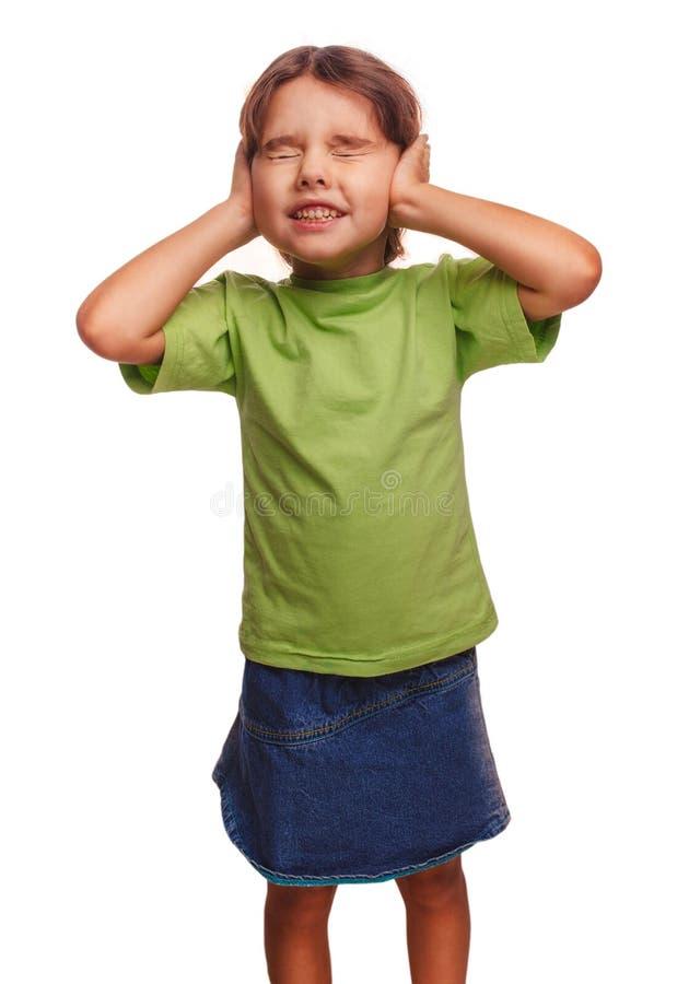 Χέρια μωρών κοριτσιών εφήβων που καλύπτουν τα αυτιά της και κλειστά στοκ φωτογραφία με δικαίωμα ελεύθερης χρήσης