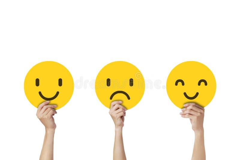 Χέρια που κρατούν τις συγκινήσεις προσώπου στη θλίψη και την ευτυχία ελεύθερη απεικόνιση δικαιώματος