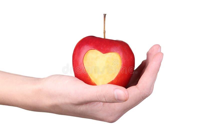 Χέρια που κρατούν το μήλο στοκ εικόνα