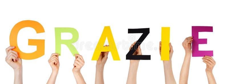 Χέρια που κρατούν grazie στοκ φωτογραφία