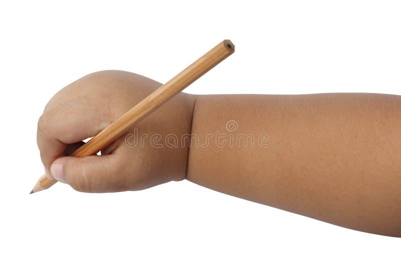 Χέρι αγοριών που γράφει με απομονωμένη τη μολύβι πορεία ψαλιδίσματος στοκ εικόνες