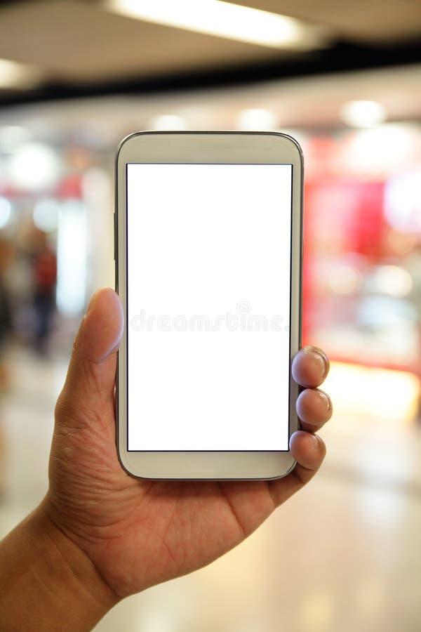 Χέρι ατόμων που κρατά το έξυπνο τηλέφωνο στοκ φωτογραφία με δικαίωμα ελεύθερης χρήσης