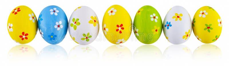 χέρι αυγών Πάσχας που χρωμ&alph διανυσματική απεικόνιση