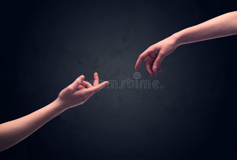 Χέρι για να αγγίξει περίπου ένα άλλο ένα στοκ φωτογραφίες