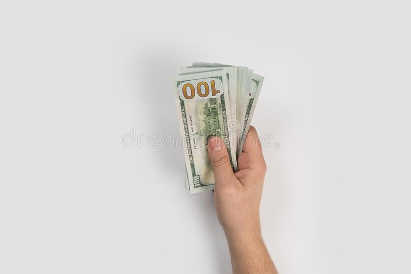 Χέρι γυναικών με τα δολάρια στοκ εικόνα
