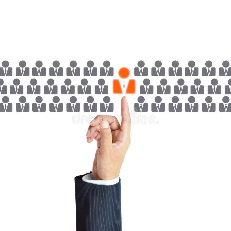 Χέρι επιχειρηματιών που δείχνει το ανθρώπινο εικονίδιο - ωρ., έννοιες HRM στοκ φωτογραφίες με δικαίωμα ελεύθερης χρήσης