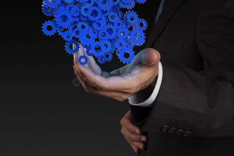 Χέρι επιχειρηματιών που παρουσιάζει βαραίνω εργαλείων στοκ εικόνα