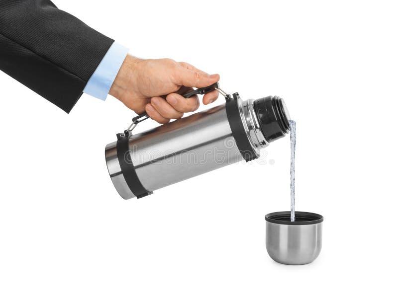 Χέρι και φιάλη thermos στοκ φωτογραφίες με δικαίωμα ελεύθερης χρήσης