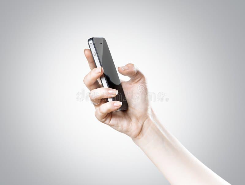 Χέρι και smartphone στοκ εικόνα