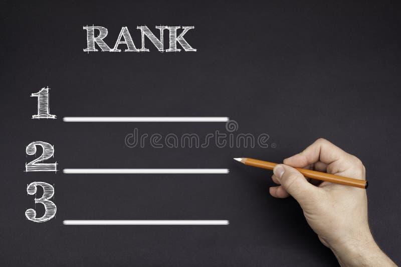 Χέρι με ένα άσπρο μολύβι που γράφει: Πυκνός κενός κατάλογος στοκ φωτογραφίες