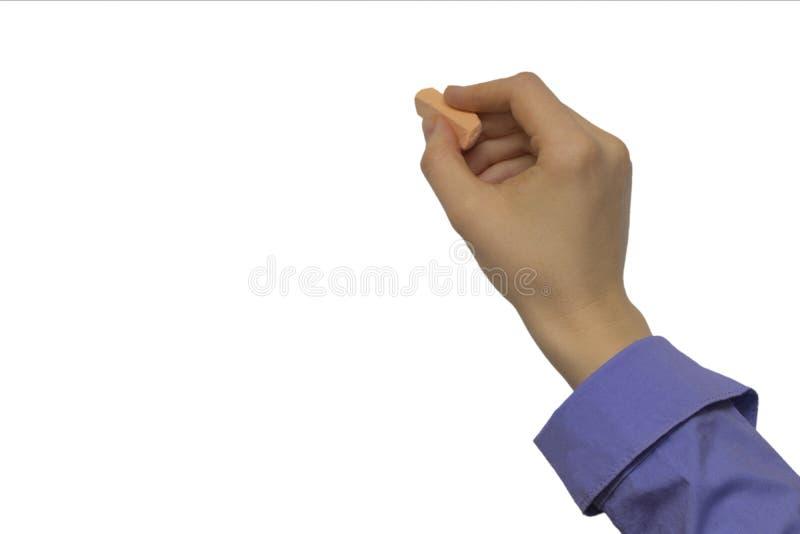 Χέρι με την κιμωλία και το μαύρο πίνακα στοκ φωτογραφία με δικαίωμα ελεύθερης χρήσης