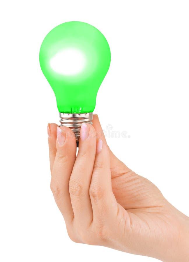 Χέρι με τον πράσινο λαμπτήρα στοκ φωτογραφίες