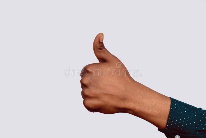 Χέρι με τους αντίχειρες επάνω στοκ φωτογραφίες