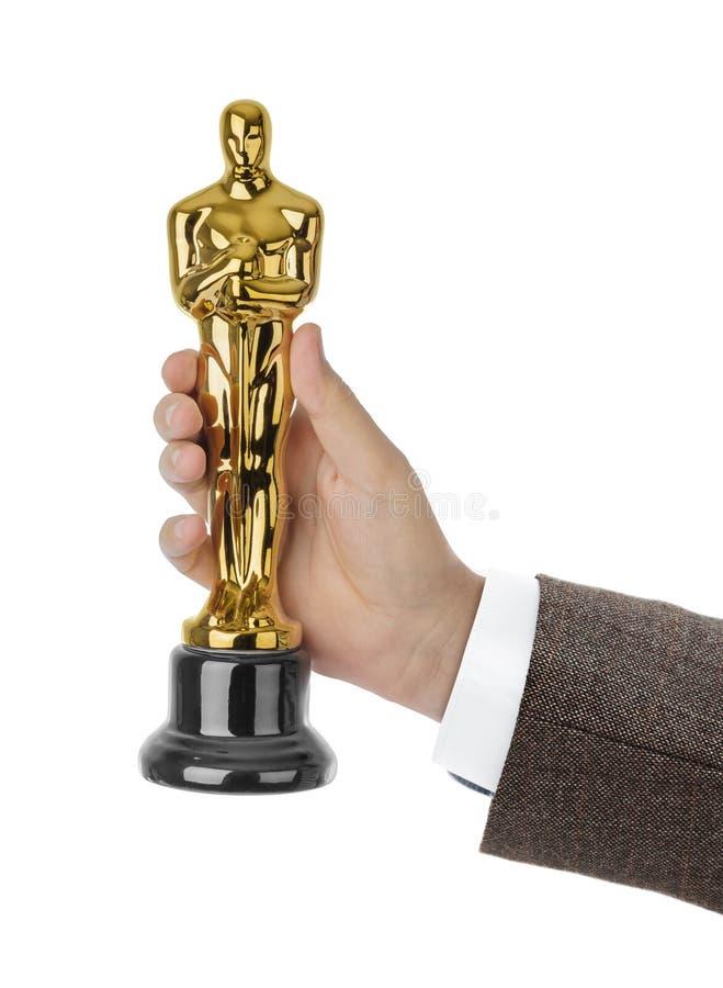 Χέρι με το βραβείο της τελετής του Oscar στοκ φωτογραφία με δικαίωμα ελεύθερης χρήσης