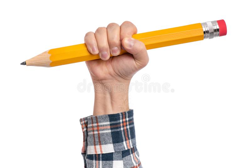Χέρι με το μεγάλο μολύβι στοκ φωτογραφίες