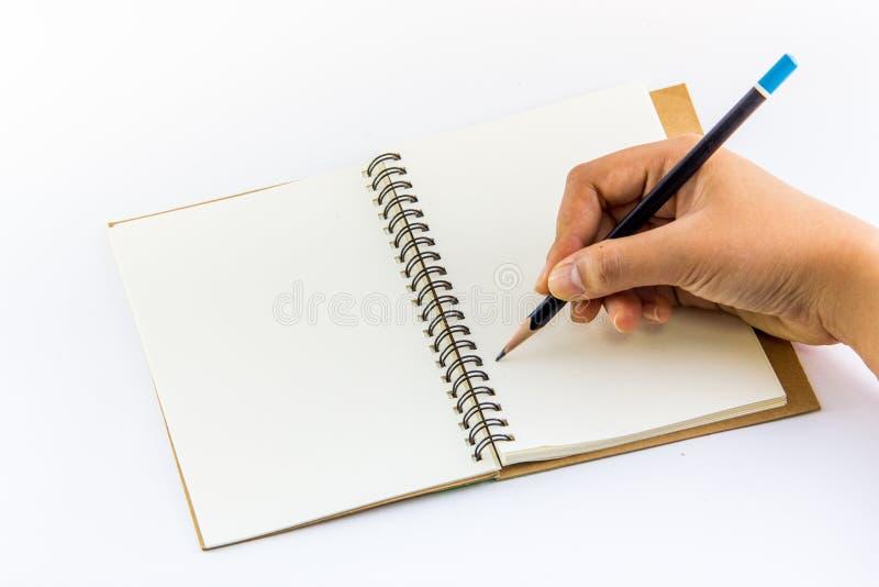Χέρι που γράφει στο σημειωματάριο στοκ φωτογραφία