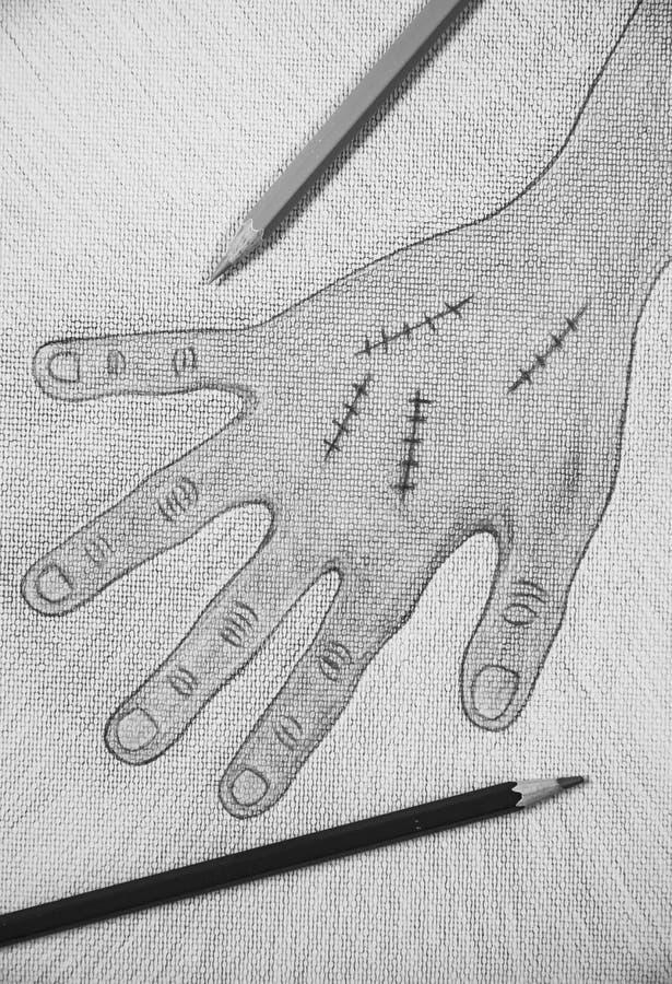 Χέρι που επισύρεται την προσοχή δεξί με τη συρραφή πληγών στο υπόβαθρο της Λευκής Βίβλου, έννοια αποκριών στοκ εικόνα με δικαίωμα ελεύθερης χρήσης