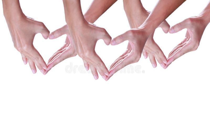 Χέρι που κάνει μια μορφή καρδιών σε ένα άσπρο υπόβαθρο στοκ φωτογραφία με δικαίωμα ελεύθερης χρήσης