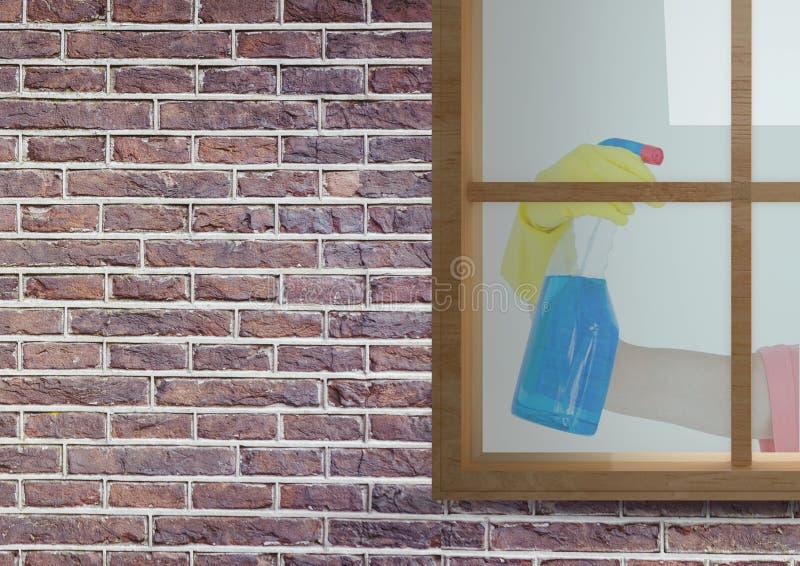 χέρι που καθαρίζει το παράθυρο του σπιτιού τούβλων στοκ εικόνα με δικαίωμα ελεύθερης χρήσης