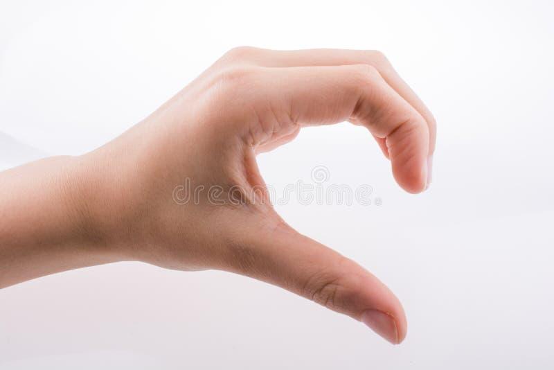 Χέρι που κατασκευάζει μια μισή καρδιά στοκ εικόνα