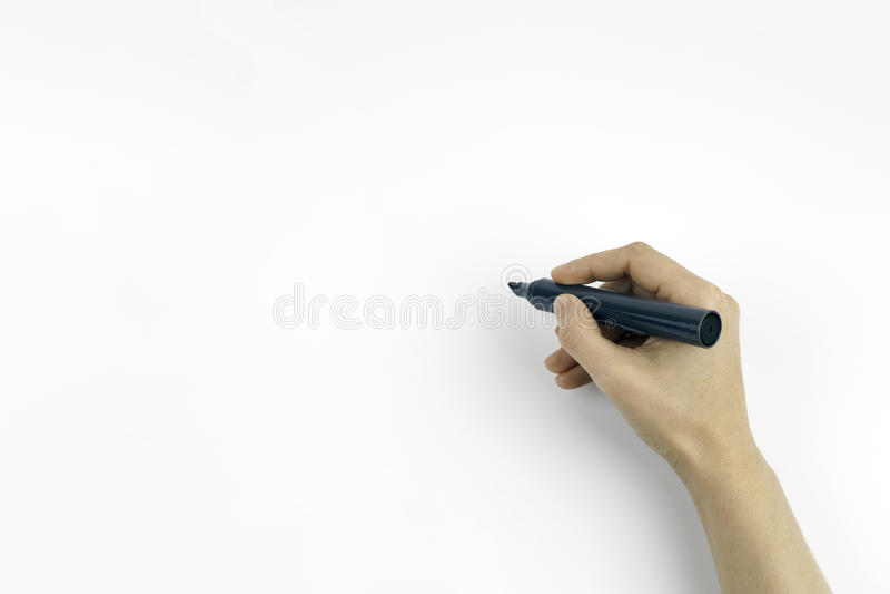 Χέρι που κρατά έναν μαύρο δείκτη απομονωμένο στο λευκό με το διάστημα αντιγράφων στοκ φωτογραφία με δικαίωμα ελεύθερης χρήσης