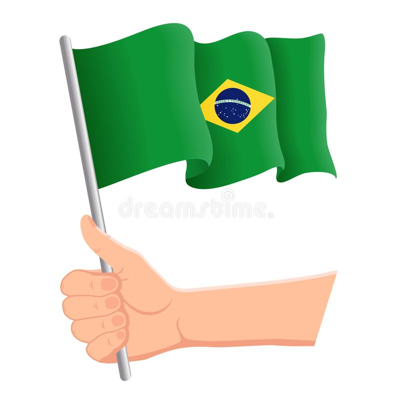 Χέρι που κρατά και που κυματίζει τη εθνική σημαία της Βραζιλίας Ανεμιστήρες, ημέρα της ανεξαρτησίας, πατριωτική έννοια r ελεύθερη απεικόνιση δικαιώματος