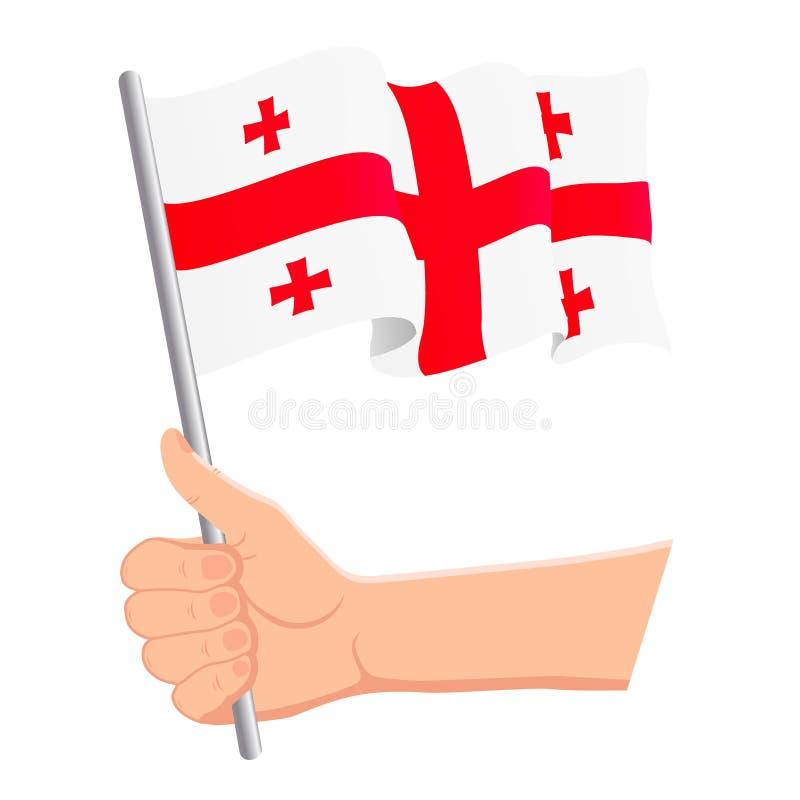 Χέρι που κρατά και που κυματίζει τη εθνική σημαία της Γεωργίας Ανεμιστήρες, ημέρα της ανεξαρτησίας, πατριωτική έννοια r απεικόνιση αποθεμάτων