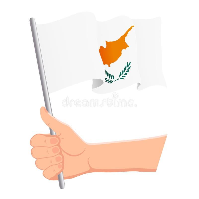 Χέρι που κρατά και που κυματίζει τη εθνική σημαία της Κύπρου Ανεμιστήρες, ημέρα της ανεξαρτησίας, πατριωτική έννοια r ελεύθερη απεικόνιση δικαιώματος