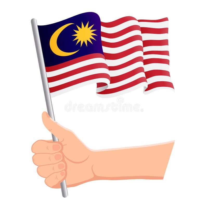 Χέρι που κρατά και που κυματίζει τη εθνική σημαία της Μαλαισίας Ανεμιστήρες, ημέρα της ανεξαρτησίας, πατριωτική έννοια r διανυσματική απεικόνιση