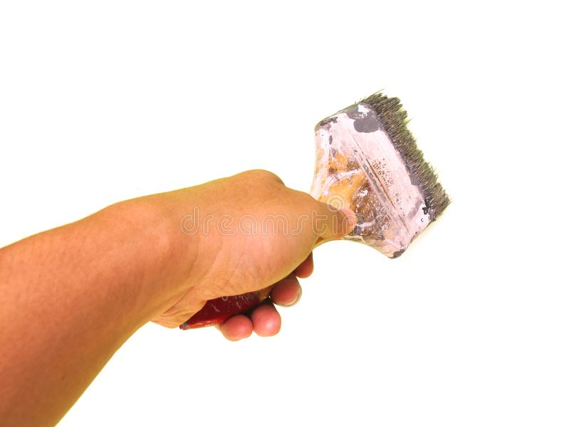 Χέρι που κρατά μια βούρτσα χρωμάτων, που απομονώνεται στο άσπρο υπόβαθρο στοκ εικόνες με δικαίωμα ελεύθερης χρήσης