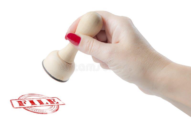Χέρι που κρατά μια σφραγίδα με το αρχείο λέξης στοκ εικόνες με δικαίωμα ελεύθερης χρήσης
